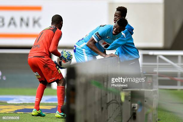 Kalifa Coulibaly forward of KAA Gent is joking with Barry Boubacar Copa goalkeeper of Sporting Lokeren during the Jupiler Pro League match between...