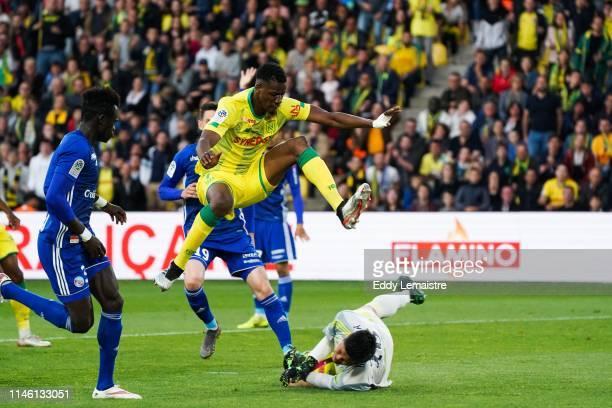 Kalifa Coulibaly of Nantes and Eiji Kawashima of Strasbourg during the Ligue 1 match between Nantes and Strasbourg on May 24 2019 in Nantes France