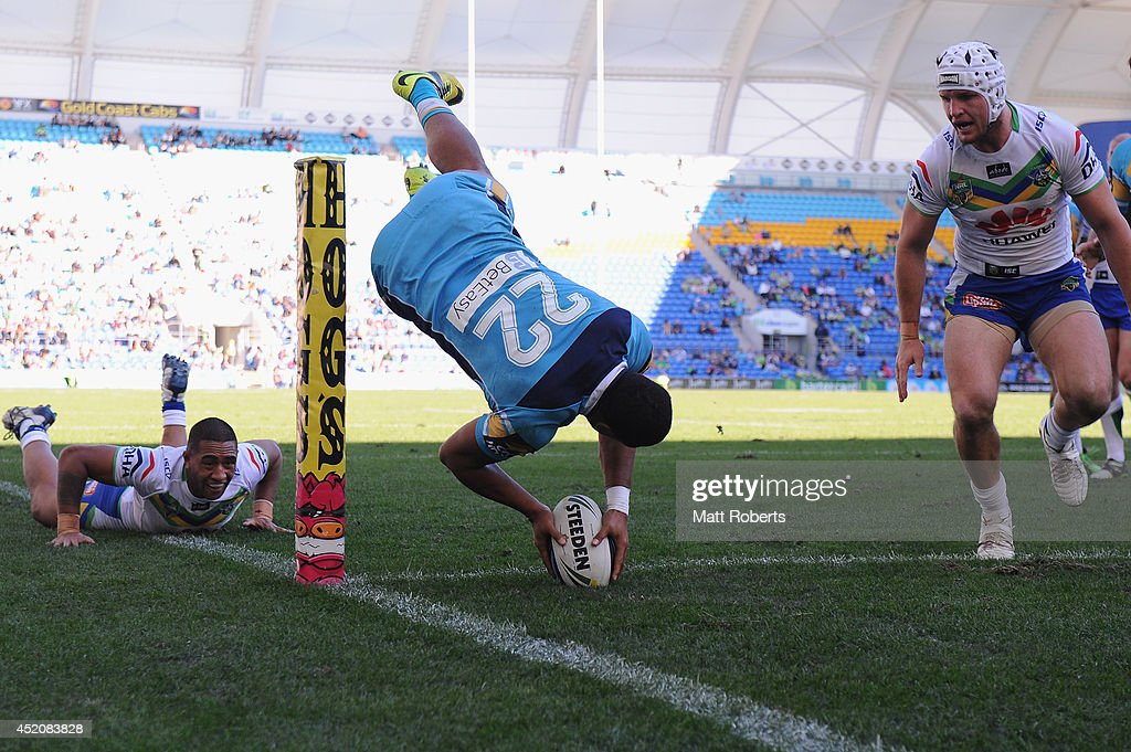 Kalifa Faifai Loa of the Titans scores a try during the round 18 NRL match between the Gold Coast Titans and the Canberra Raiders at Cbus Super Stadium on July 13, 2014 on the Gold Coast, Australia.