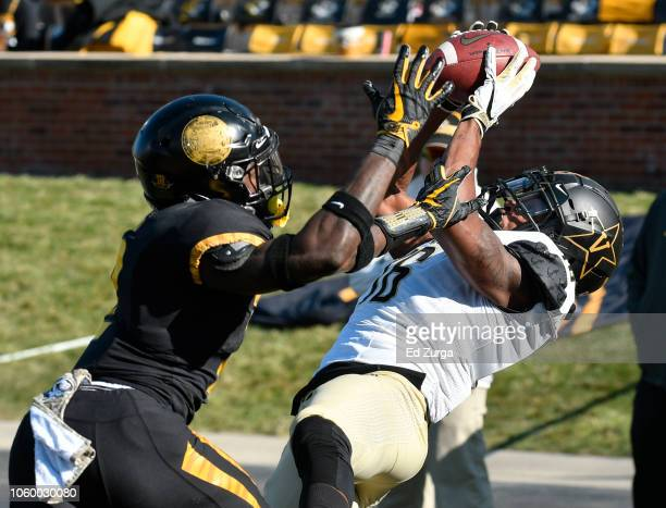 Kalija Lipscomb of the Vanderbilt Commodore catches a touchdown pass against defensive back DeMarkus Acy of the Missouri Tigers in the third quarter...