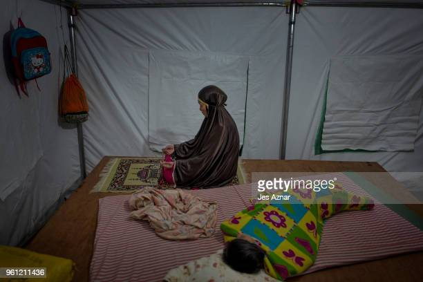 Kalili Ali prays the Tarawe inside their shelter as the makeshift mosque for them was not finished in time for the start of Ramadan on May 16 2018 in...