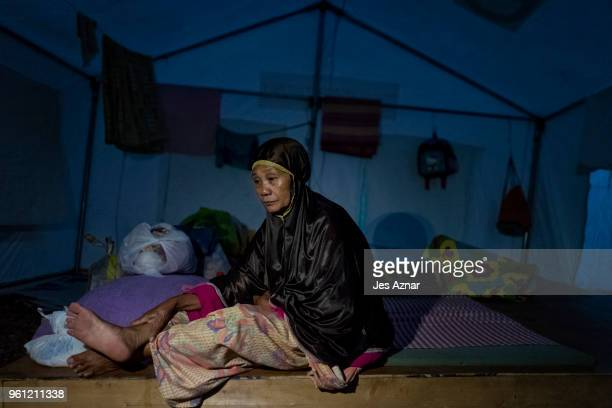 Kalili Ali sitting inside their shelter as she waits for the intermittent electricity to turn on again inside the Sarimanok tent city on May 16 2018...