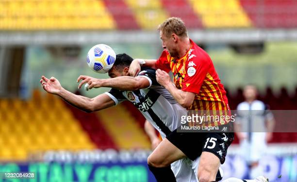 Kalim Glik of Benevento competes for the ball in air with Graziani Pellè of Parma during the Serie A match between Benevento Calcio and Parma Calcio...