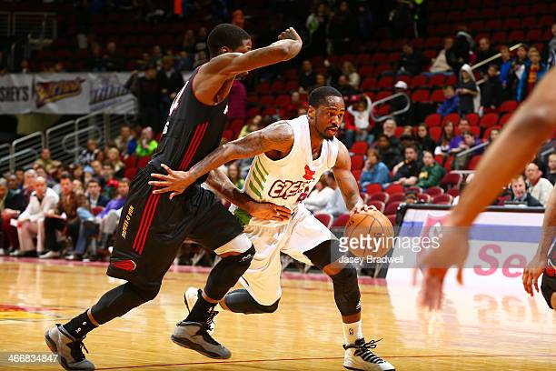 Kalin Lucas of the Iowa Energy drives around DeAndre Liggins of the Sioux Falls Skyforce in an NBA DLeague game on February 1 2014 at the Wells Fargo...