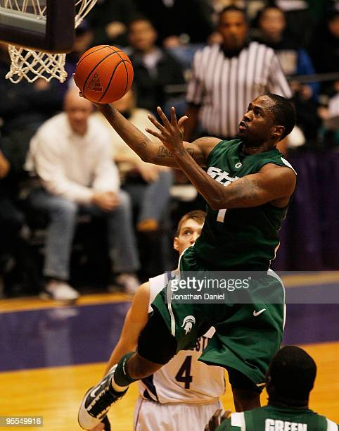 Kalin Lucas of the Michigan State Spartans drives to the basket past Alex Marcotullio of the Northwestern Wildcats on January 2 2010 at WelshRyan...
