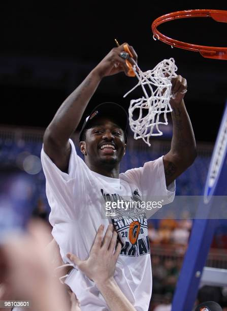 Kalin Lucas of the Michigan State Spartans is lifted by his teammates to cut the net during the midwest regional final of the 2010 NCAA men's...