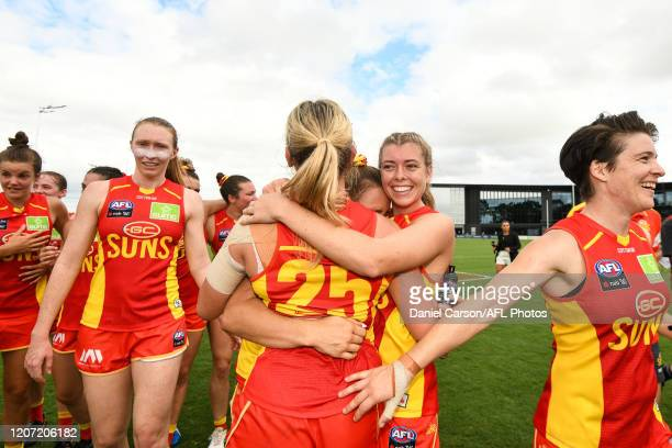 Kalinda Howarth of the Suns celebrate the win with her team during the 2020 AFLW Round 06 match between the West Coast Eagles and the Gold Coast Suns...