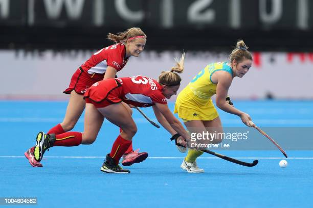 Kalindi Commerford of Australia gets away from Alix Gerniers of Belgium and AnneSophie Weyns of Belgium during the Pool D game between Australia and...