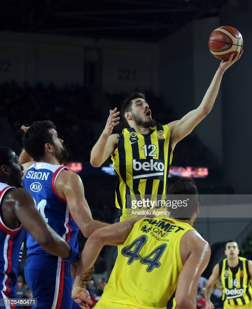 Kalinic of Fenerbahce Beko in action against Simon of Anadolu Efes during Turkish Cup final basketball match between Fenerbahce Beko and Anadolu Efes...