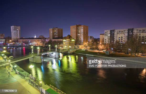 kaliningrad / königsberg - view over the river pregolya ( pregel ) seen from fish village with the kaiserbruecke / kaiserbrücke / anniversary bridge in foreground. - east prussia stock pictures, royalty-free photos & images
