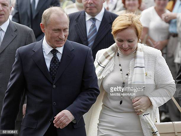 Russian President Vladimir Putin smiles as he talks to his wife Lyudmila in Kaliningrad 02 July 2005 Putin will welcome German Chancellor Gerhard...