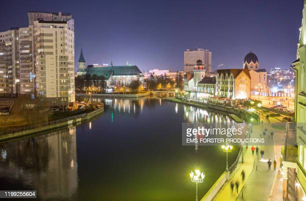 kaliningrad - view over the river pregolya ( pregel ) from fish village towards the old königsberg cathedral on kant's island ( kneiphof ) and further back the house of soviets. - east prussia stock pictures, royalty-free photos & images