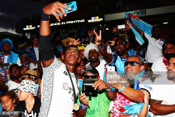 Kalione Nasoko of Fiji celebrates with fans after winning the Cup final match between Fiji and South Africa the 2018 New Zealand Sevens at FMG...