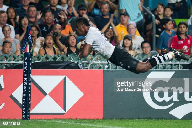 Kalione Nasoko of Fiji flies to score a try against Souht Africa during their Cup final match as part of the 2017 Hong Kong Sevens at Hong Kong...