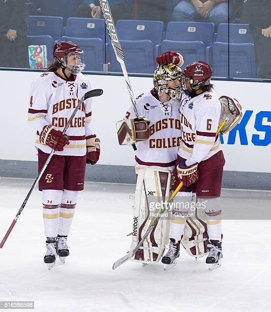 Kaliya Johnson of the Boston College Eagles celebrates her late goal that tied the game against the Clarkson Golden Knights with teammates Katie Burt...