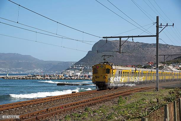 Kalk Bay Western Cape South Africa The Scenic Coastal Suburban Railroad Line Which Runs Between Cape Town And Simpn'S Town Seen Here Passing Kalk Bay...