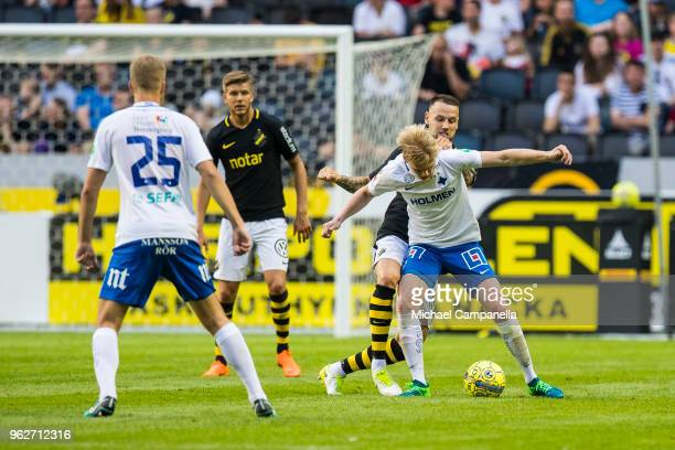 Kalle Holmberg of IFK Norrkoping in a duel with Alexander Milosevic of AIK during an Allsvenskan match between AIK and IFK Norrkoping at Friends...