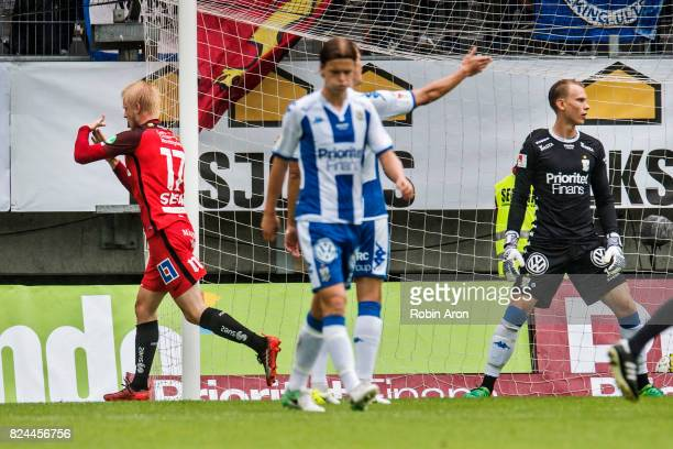 Kalle Holmberg of IFK Norrkoping scores the opening goal 01 and Pontus Dahlberg goalkeeper of IFK Goteborg dejected during the Allsvenskan match...