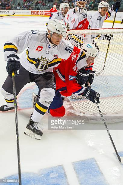 Kalle Kaijomaa of Espoo Blues in action with Christoph Ullmann of Adler Mannheim during the Champions Hockey League round of thirty-two game between...
