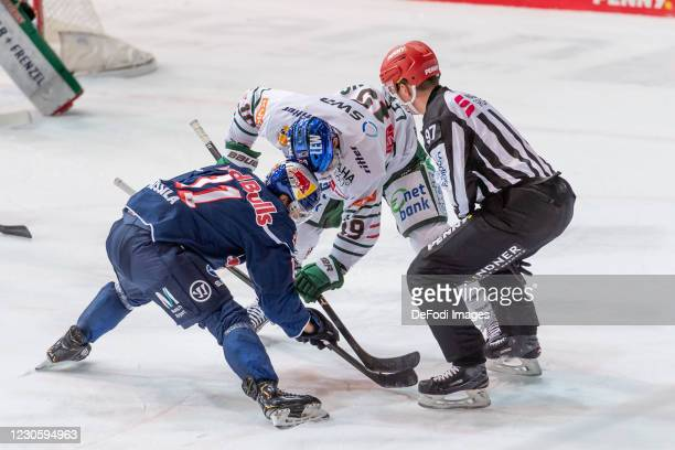 Kalle Kossila of EHC Red Bull Muenchen and Andrew LeBlanc of Augsburger Panther at the bully during the DEL match between EHC Red Bull Muenchen and...