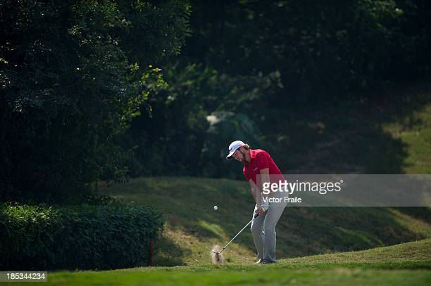 Kalle Samooja of Finland chips into the 5th green during day three of the Venetian Macau Open at Macau Golf and Country Club on October 19 2013 in...