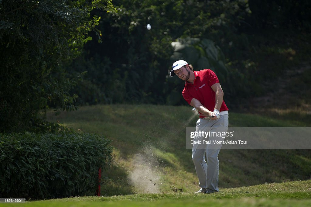 Kalle Samooja of Finland hits out of the rough during round three of the Venetian Macau Open on October 19, 2013 at the Macau Golf & Country Club in Macau. The Asian Tour tournament offers a record US$ 800,000 prize money which goes through October 20.
