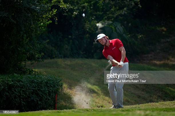 Kalle Samooja of Finland hits out of the rough during round three of the Venetian Macau Open on October 19 2013 at the Macau Golf Country Club in...