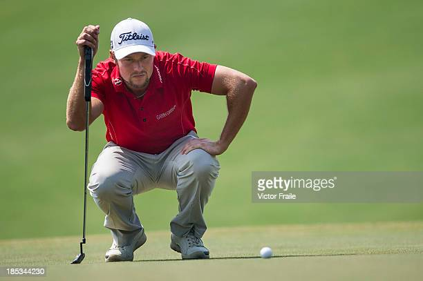 Kalle Samooja of Finland lines up a putt on the 5th green during day three of the Venetian Macau Open at Macau Golf and Country Club on October 19...