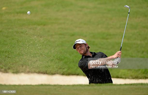 Kalle Samooja of Finland plays a shot during round three of the Resorts World Manila Masters at Manila Southwoods Golf and Country Club on November...