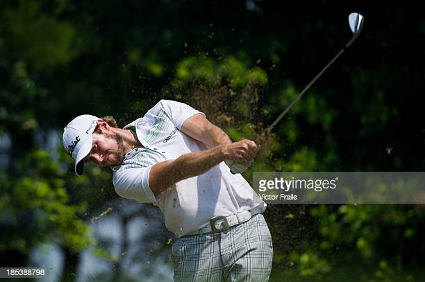 Kalle Samooja of Finland tees off on the 6th hole during day four of the Venetian Macau Open at Macau Golf and Country Club on October 20 2013 in...