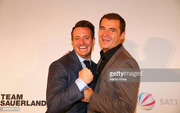Kalle Sauerland ceo of Sauerland Box Promotions poses with Zeljko Karajica of Sat1 after the press conference at Hotel Adlon on October 9 2014 in...