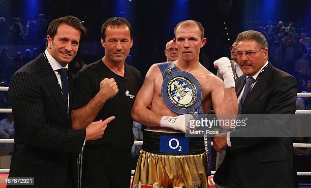 Kalle Sauerland coach Karsten Roever Juergen Braehmer and Peter Hanraths celebrate after the European Light Heavyweight title fight at Sporthalle...
