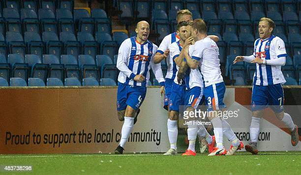 Kallum Higginbotham of Kilmarnock is congratulated by his team mates after scoring his team's second and final goal during the Scottish premiership...