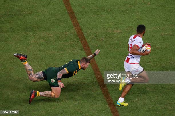 Kallum Watkins of England evades the tackle of Josh Dugan of Australia during the 2017 Rugby League World Cup Final between the Australian Kangaroos...