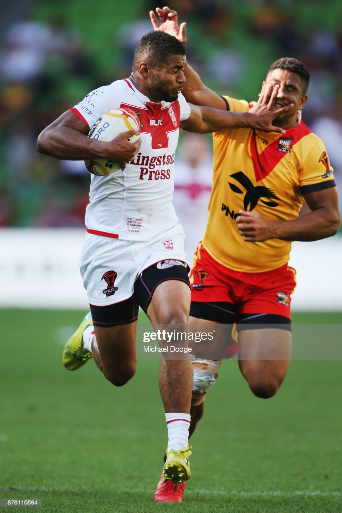 Kallum Watkins of England fends off and runs with the ball on his way to a try during the 2017 Rugby League World Cup Quarter Final match between England and Papua New Guinea Kumuls at AAMI Park on November 19, 2017 in Melbourne, Australia.