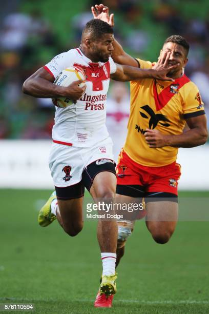 Kallum Watkins of England fends off and runs with the ball on his way to a try during the 2017 Rugby League World Cup Quarter Final match between...