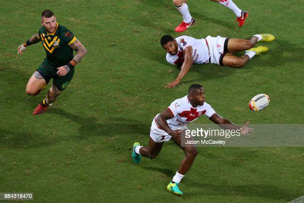Kallum Watkins of England intercepts the ball during the 2017 Rugby League World Cup Final between the Australian Kangaroos and England at Suncorp...