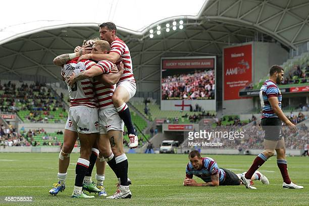 Kallum Watkins of England is congratulated by team mates after scoring a try during the Four Nations match between the Australian Kangaroos and...
