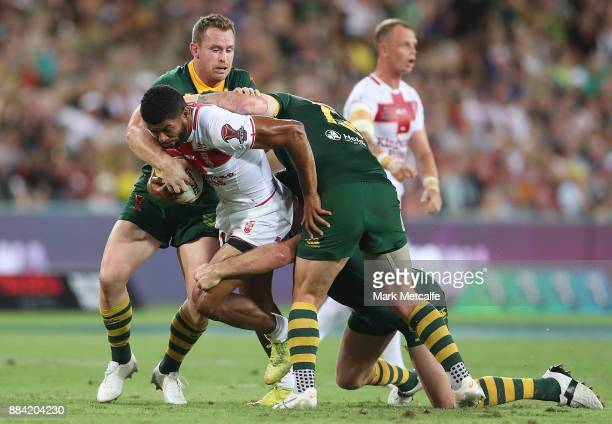 Kallum Watkins of England is tackled during the 2017 Rugby League World Cup Final between the Australian Kangaroos and England at Suncorp Stadium on...