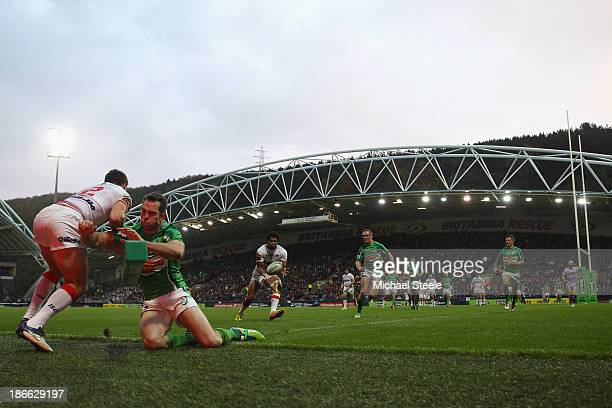 Kallum Watkins of England receives a pass from Tom Briscoe to score a try during the Rugby League World Cup Group A match between England and Ireland...