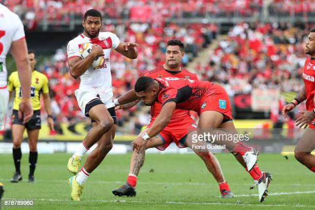 Kallum Watkins of England spins in the tackle during the 2017 Rugby League World Cup Semi Final match between Tonga and England at Mt Smart Stadium...