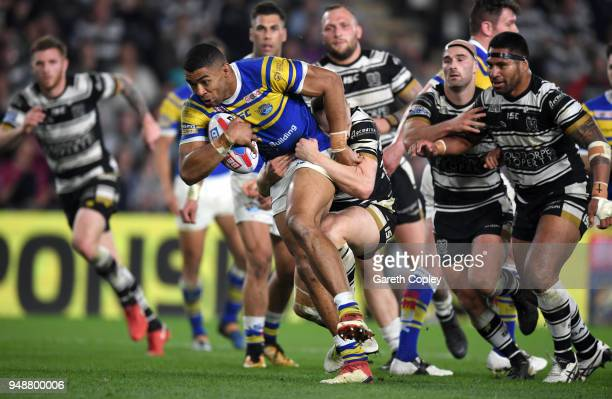 Kallum Watkins of Leeds makes a break during the BetFred Super League match between Hull FC and Leeds Rhinos at KCOM Stadium on April 19 2018 in Hull...