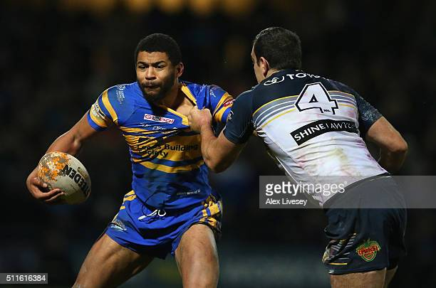 Kallum Watkins of Leeds Rhinos is tackled by Kane Linnett of North Queensland Cowboys during the World Club Series match between Leeds Rhinos and...