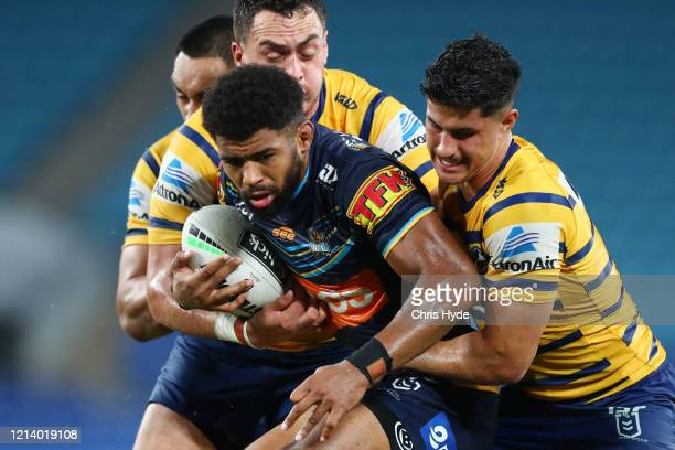 Kallum Watkins of the Titans is tackled during the round 2 NRL match between the Gold Coast Titans and the Parramatta Eels at Cbus Super Stadium on...