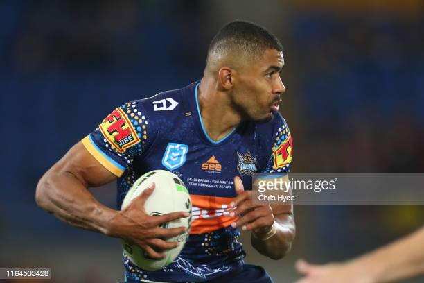 Kallum Watkins of the Titans runs the ball during the round 19 match between the Gold Coast Titans and the Brisbane Broncos at Cbus Super Stadium on...