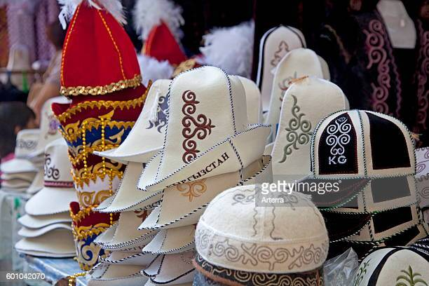 Kalpaks highcrowned caps made of felt for sale at market stand in Osh Kyrgyzstan