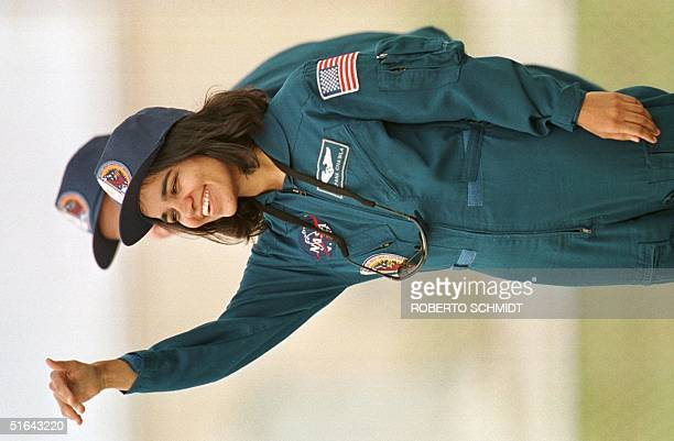 Kalpana Chawla an IndianAmerican astronaut waves to well wishers and family members during a photo opportunity 18 November in the perimeter of launch...