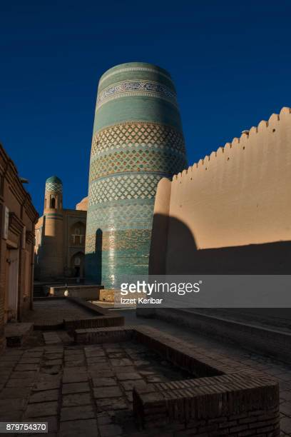 Kalta Minor minaret and close crenated walls at Khiva, Uzbekistan