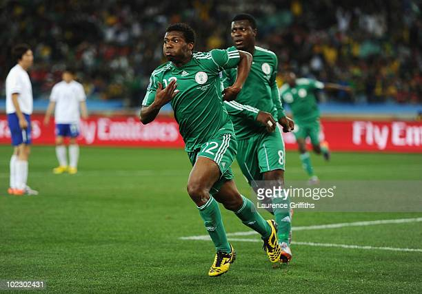 Kalu Uche of Nigeria celebrates with team mate Yakubu Ayegbeni after scoring the opening goal during the 2010 FIFA World Cup South Africa Group B...