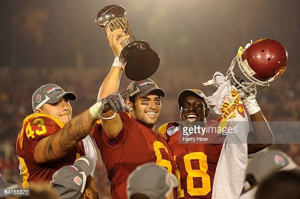 Kaluka Maiava quarterback Mark Sanchez and Damian Williams of the USC Trojans celebrate with the trophy after defeating the Penn State Nittany Lions...